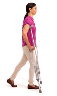 Woman walking with two crutches.