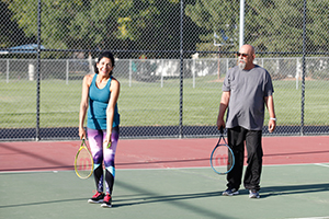 Man and woman playing tennis.